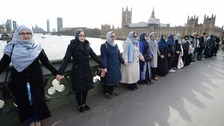 Women gather on Westminster Bridge.