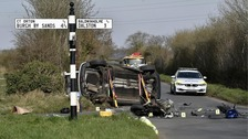 Police at the Great Orton crash scene yesterday