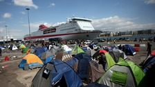 Migrants camped outside Piraeus ferry terminal