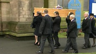 Bill Tarmey's coffin is carried into the Albion United Reform Church in Manchester.