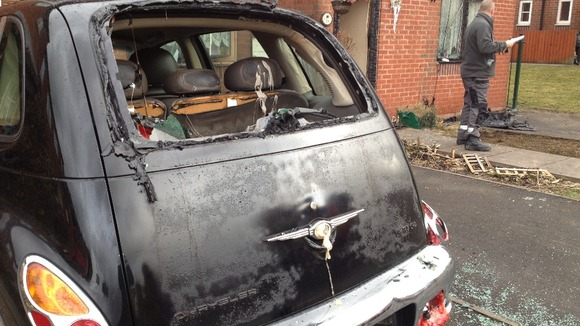 The fire has damaged cars and homes in the surrounding areas 