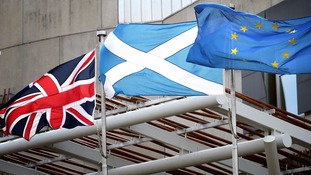 British, Scottish and EU flags outside the Scottish Parliament in Edinburgh