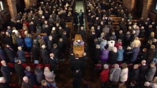 Bill Tarmey's coffin is carried into the Albion United Reform Church in Manchester