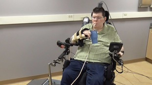 Paralysed man moves arm and hand with thought-controlled technology