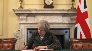 Theresa May signs the Article 50 letter, as she prepares to trigger the start of the UK's formal withdrawal.