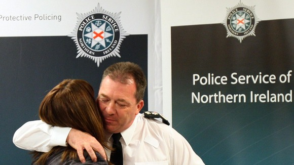 Constable Stephen Carroll's widow Kate Carroll with Chief Constable Matt Baggott.