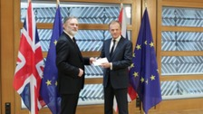 Britain's Ambassador to the EU, Sir Tim Barrow delivers the Brexit letter to EU Council President Donald Tusk, in Brussels, Belgium.
