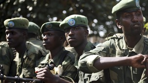 FARDC soldiers sit in a military truck in Minova, west of Goma