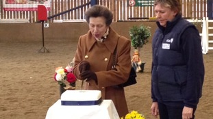 Princess Anne cutting a cake