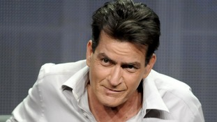 Charlie Sheen was fired from Two and a Half Men in March last year