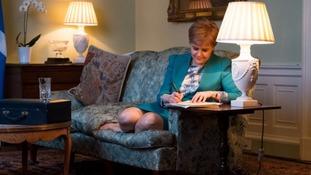 Nicola Sturgeon signing Scottish independence referendum