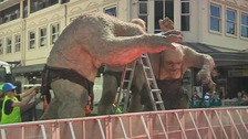 Sculptures being moved into place ahead of The Hobbit's world premiere in New Zealand