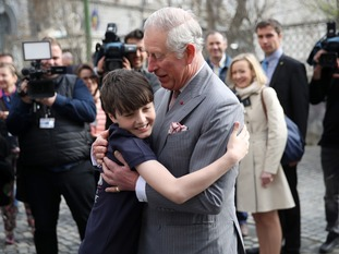 The son of one of the volunteers, Valentin Blacker, hugged the Prince
