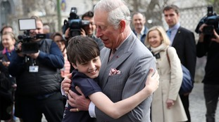Adorable moment Prince Charles is given a huge hug on Romania tour