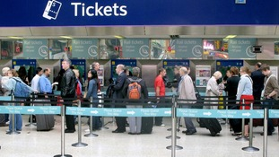 File photo of people queuing for train tickets