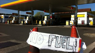 Petrol stations ration fuel as panic buying eases