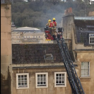 Firefighters over the roof tops.