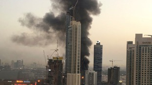 Skyscraper fire near Dubai's biggest mall shrouds city in smoke