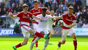 Swansea City's Leroy Fer (centre) in action against Middlesbrough's Marten de Roon (left) and Middlesbrough's Ben Gibson