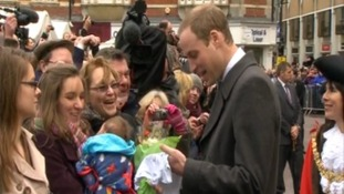Prince William talks to mum and baby.