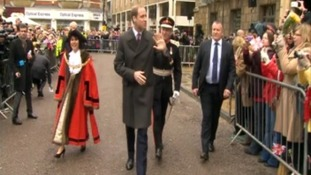 The Duke of Cambridge waves to the crowds.