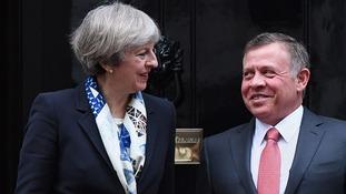 King Abdullah II Theresa May