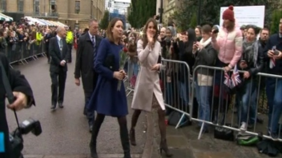 The Duchess of Cambridge waves to the crowds.