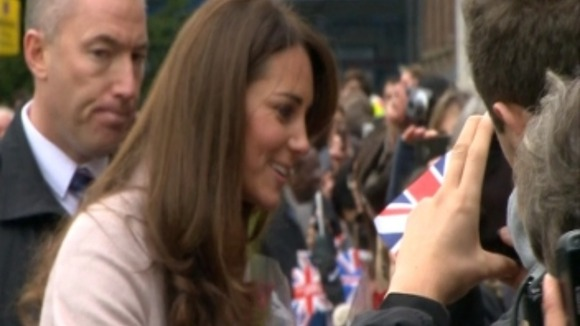The people of Cambridge hold their British flags.