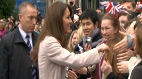 The crowd are delighted to catch a glimpse of the Duchess.