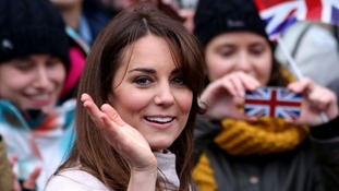 The Duchess of Cambridge waves during a walkabout in the centre of Cambridge.