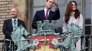 The Royal couple appear on the balcony of the Guildhall in Cambridge.