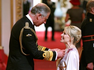 The pop princess getting an OBE from Prince Charles for services to music.