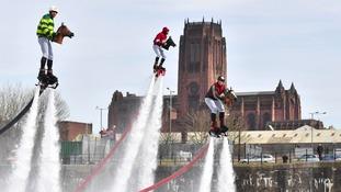 Grand Splash-ional! Water jet-pack jockeys in Liverpool ahead of Aintree race