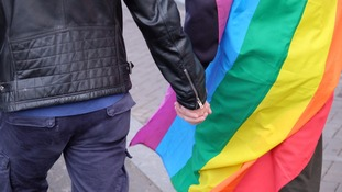 People held hands in Amsterdam in solidarity with a gay couple who were beaten up