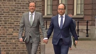Dutch politicians hold hands in support of gay couple who were attacked