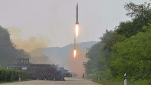 File photo of ballistic missiles being fired during a test drill in North Korea