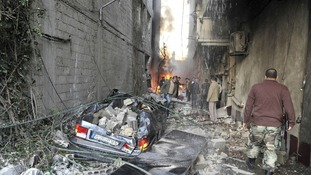 Crowd gathers at the site of a blast in Jaramana district, near Damascus