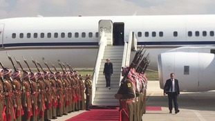 Theresa May flew to Ammam in Jordan on a charter flight instead.