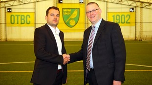 Stuart Webber (left) shakes hands with Managing Director Steve Stone (right) following his appointment.