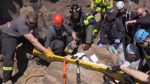 Woman gets trapped under falling boulder while hiking