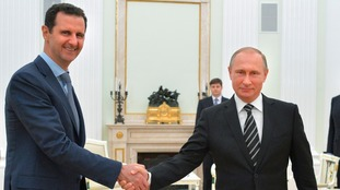 Vladimir Putin and Bashar Assad at a meeting in 2015.