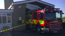 The fire engine was wedged in at Manea station in Cambridgeshire.