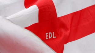 A St George's Cross flag is flown during an English Defence League march