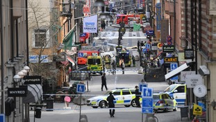 The scene in Drottninggatan, a shopping street in Stockholm, following the crash.