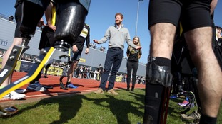 Prince Harry chats to competitors.