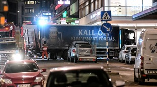 The lorry used in the suspected terror attack has been towed away from the central shopping street in Stockholm.