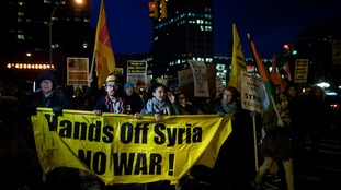 Protesters held a rally in New York to demonstrate against the US missile strikes.
