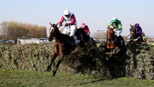 One For Arthur ridden by jockey Derek Fox jumps the last on the way to winning the Grand National.