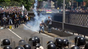 Demonstrators clashed with riot police during a protest in Caracas.