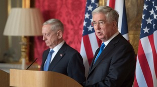 The defence secretary, seen alongside his American counterpart Jim Mattis, reiterated his support for the US airstrikes.